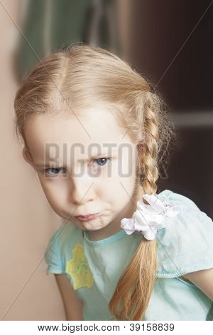 Funny Portrait Of A Little Girl Making Grimace