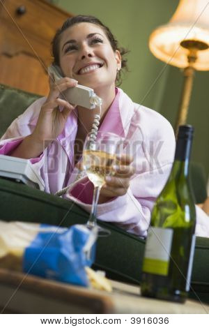 Woman On Phone Drinking