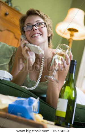 Woman On Phone With Glass Of Wine