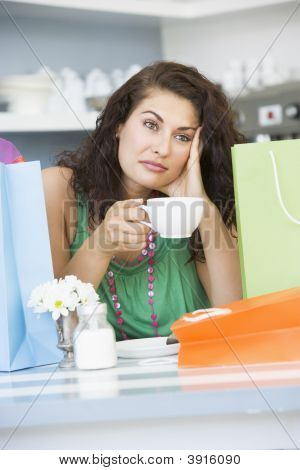 Woman Looking Sad Drinking Tea