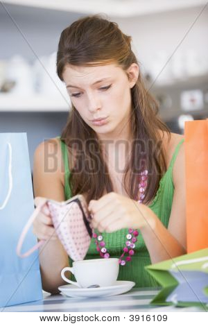 Woman In Tea Room With No Money In Purse