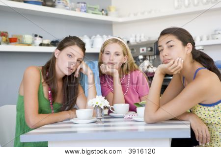 Girlfriends Looking Fed Up In Tea Room
