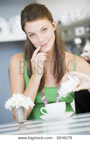 Woman Looking Naughty For Having Sugar In Tea