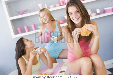 Girlfriends Enjoying Tea And Croissants
