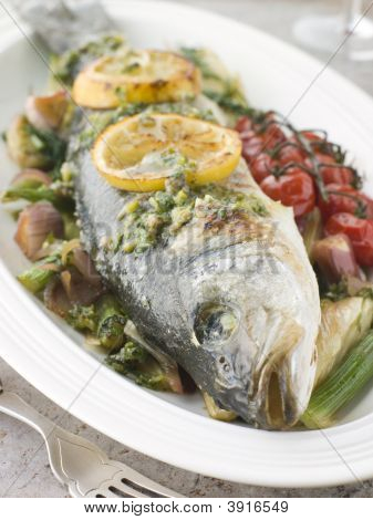 Whole Roasted Sea Bass With Fennel Lemon Cherry Vine Tomatoes And Salsa Verde