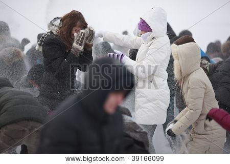 SAMARA,RUSSIA - JANUARY 28: Unidentified Russian students take a part in massive snowball fight on January 28,2012 on the frozen Volga river near Samara upper beach