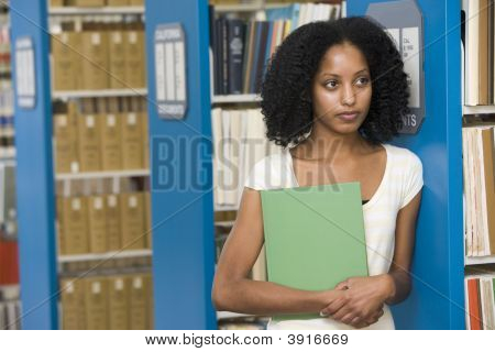 Woman In Library Holding Book (Depth Of Field)