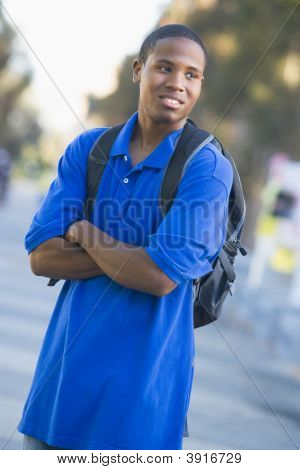 Man Standing Outdoors Looking At Something (Selective Focus)