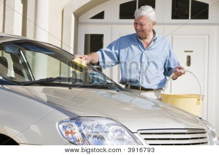 Senior Man Washing His Car Outside House