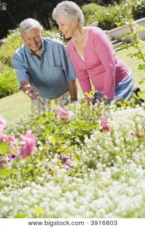 Senior Couple In A Flower Garden