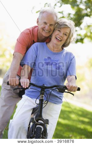Senior Couple On A Bicycle