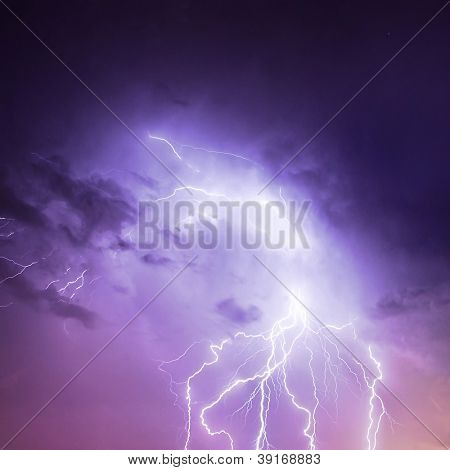 Picture of discharge lightning in cloudy purple sky, abstract natural background, thunderstorm in the rainy night, thunder and zipper, powerful electrical charge in dark blue skyscape, autumn weather