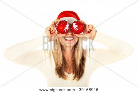 Photo of pretty blond girl wearing santa claus hat isolated on white background, cute woman holding two red cristmas toy in hands, new year party, holiday celebration, happiness concept