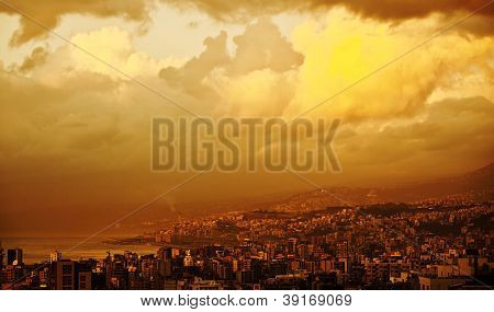 Photo of orange sunset in the city on coastline, Beirut, Lebanon, beautiful yellow sundown in the town near sea, dramatic cityscape, urban landscape, middle east, travel and tourism concept