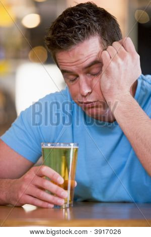 Innebriated Man With Glass Of Beer