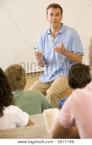 Teacher Giving Lecture To Students In Classroom (Selective Focus)