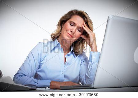 Business woman having a headache. Office work.
