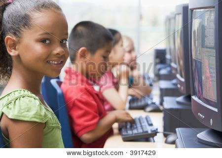 Four Children At Computer Terminals (Depth Of Field/High Key)