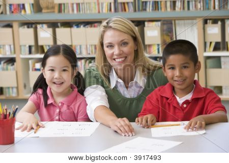 Two Students In Class With Teacher