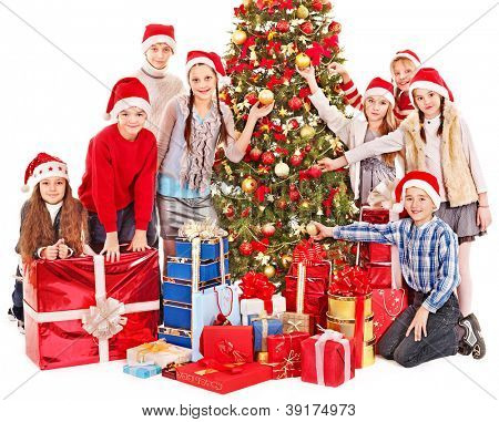 Group of children with Santa Claus and Christmas tree.  Isolated.