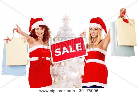 Women in Santa hat holding sign saying sale and gift box.