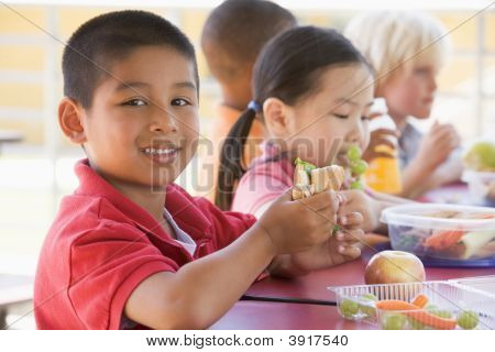 Students Outdoors Eating Lunch (Selective Focus)