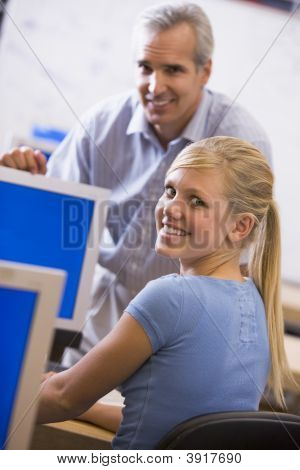 Teacher With Female Student In Computer Class