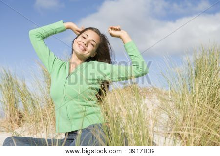 Young Woman Posing On A Sand Hill