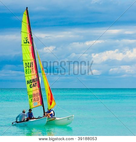 VARADERO,CUBA-NOVEMBER 3:Young couple sailing on a catamaran November 3,2012 in Varadero.With over a million visitors per year,Varadero is the destination of 40% of tourists visiting the island