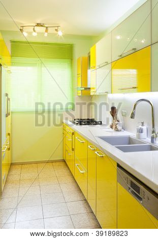 Modern design kitchen with yellow and green elements