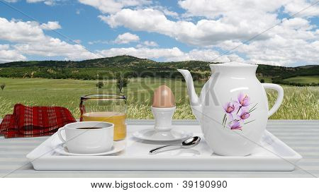 Breakfast set in front of a beautiful meadow