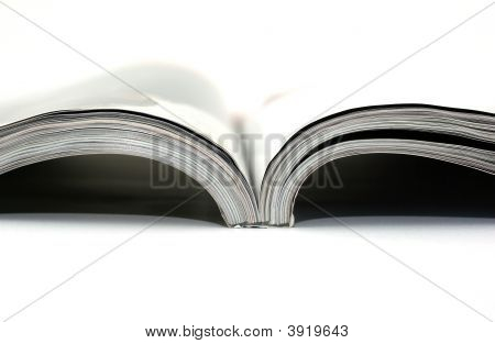 High Key Photo Of Magazine On White Background