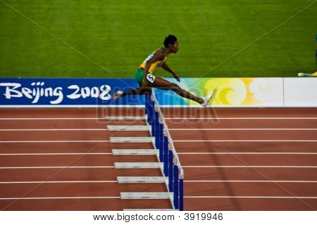 Olympic Athlete Jumps Hurdles