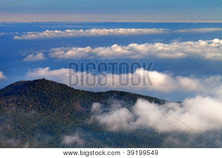Hill And Sea In Clouds