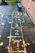 image of hopscotch  - Hopscotch on the schoolyard in the autumn - JPG