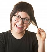 pic of fidget  - Laughing young white woman playing with her hair - JPG