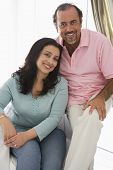 pic of close-up middle-aged woman  - Couple in living room smiling  - JPG