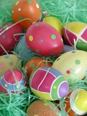 image of easter-eggs  - closeup of several easter eggs over green artifial grass - JPG