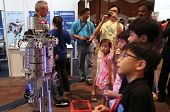 SUBANG JAYA - NOVEMBER 10: A robot performs for unidentified visitors at the World Robot Olympaid on