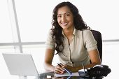 Middle Eastern Business Woman At Desk With Laptop