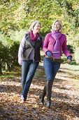 pic of senior-citizen  - Senior mother and daughter walking on path outdoors - JPG
