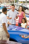 pic of hair integrations  - Mother and father with young daughter shopping for a car - JPG