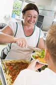 foto of tweeny  - Lunch lady serving salad to student - JPG