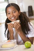 image of pre-adolescent girl  - Student in cafeteria eating lunch  - JPG