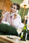 foto of housecoat  - Young woman at home talking on telephone - JPG