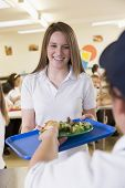 image of school lunch  - Student having lunch in dining hall - JPG