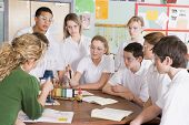 foto of medium-  length hair  - Students receiving chemistry lesson in classroom - JPG