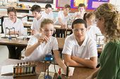 stock photo of pre-adolescent child  - Students performing science experiments in classroom - JPG