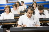 image of cornrow  - Students in music class working on keyboards - JPG