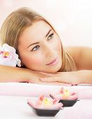 Picture of attractive woman enjoying dayspa, nice blond girl laying down on massage table in luxury spa salon, aroma therapy, beauty treatment, skin care, healthy lifestyle, relaxation concept poster